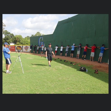 Tom House going over exercises with our pitching clinic students